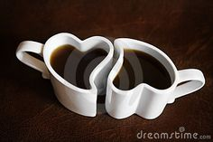 Two heart shaped cups of coffee