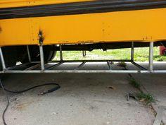 Framing for water tanks on passenger side
