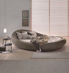 When it comes to bedroom design, a lot of people generally choose the rectangular and square beds. The truth is modern round beds can transform… Satin Bedding, Black Bedding, Sofa Design, Interior Design, Circle Bed, Silk Bed Sheets, Light Wooden Floor, Pod Chair, Round Beds