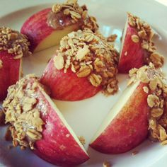 apples with nut butter rolled in granola Just found today's lunch! Yummy! My vanilla almond granola will taste awesome with this! #vegan #snacks