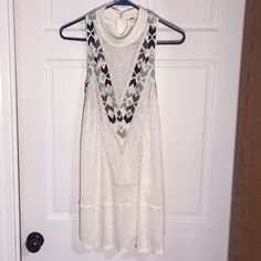 Free People Tribal White Dress -  Hot New! Free People Tribal White Dress in Size Small. Flowy, And Gorgeous. Crochet Knitting in Front with Turquoise, Light Brown and Black Chevron Stitching with Gold Bead Patterns in Between. Bought Brand New Last Month and Haven't Worn it Once! Just Been Sitting In My Closet. Mint Condition! Free People Dresses Strapless