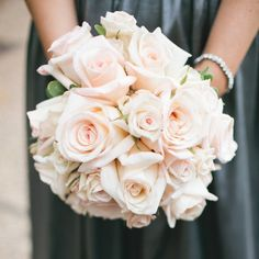 blush up lighting wedding decor | Classic white and pink roses made up the robust bridesmaid bouquets.