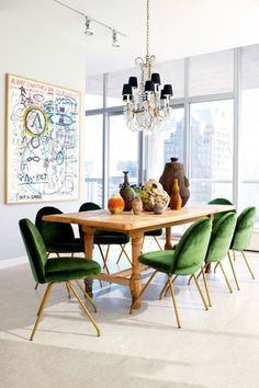 Not So Traditional Dining A farmhouse table initially doesn't seem to fit into this décor scheme, but we think the walnut shade is a perfect complement to the mod green velvet chairs.