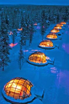 Sleep in a glass igloo at Kakslauttanen in Finland and watch the northern lights.