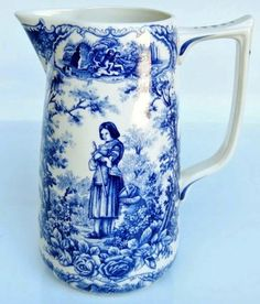 Woooow!! 9.25 in tall. Milk/water pitcher with blue transferware of Joan of Arc. Same design on BOTH sides of the pitcher. marked on bottom in same shade of blue. Exc condition!!!