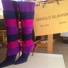 100% Authentic Manolo Blahnik multi colored boots These boots are so amazing and make you feel like Carrie Bradshaw! They're purple, navy, and magenta striped suede pointed toe boots designed by Manolo Blahnik! Own an iconic piece of fashion history today at a great price. These are size 40 (US 10) but really fit an 8.5/9. Never been worn and include bag, box, and dust bag. Manolo Blahnik Shoes