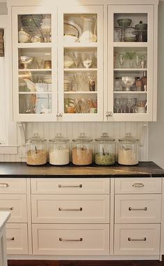 on my kitchen counter top, i store m's, nuts, etc, in clear glass pasta sauce mason jars; it's visually appealing, it beats throwing out the jars once the sauce is all used up & it keeps things organized. i want to also get apothecary jars for things like cereal, rice, pasta, flour...