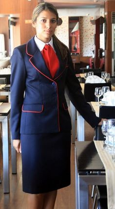 Hostess Dressed In Skirt Suit White Shirt And Red Bow