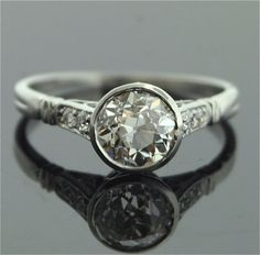 Still my hands-down fav, I think (as I love bezel set everything) 1920s Engagement Ring - Platinum and Diamond Ring $13,800