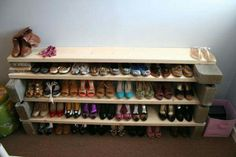 Shoe rack made using bricks and board