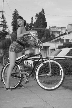 Classic Vintage Pinup Girl on Beach Cruiser Bike