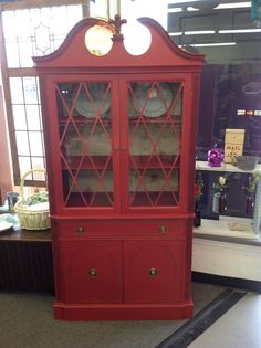 Vintage china cabinet redo in Red. My blend of calcite paint. Sprayed on. 40 years of painting and refinishing furniture. For some reason, I can't explain. This is my all time favorite piece, that I painted.