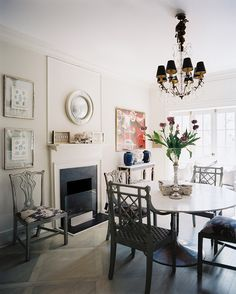 white tulip table and light-gray chairs in a dining room