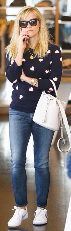 Who made  Reese Witherspoon's blue heart sweater, skinny jeans, white bucket bag, and white sneakers?