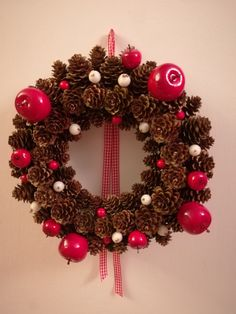 Red Christmas wreath out of cones.