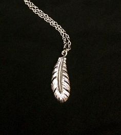A personal favorite from my Etsy shop https://www.etsy.com/listing/471085134/silver-surgical-steel-feather-pendant