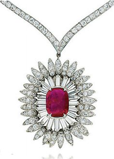 A RUBY AND DIAMOND NECKLACE, BY VAN CLEEF & ARPELS   The pendant designed as a diamond-set flower centering upon a cushion-shaped ruby, weighing 5.12 carats, to the V-shaped diamond line, necklace 38.5 cm, pendant 4.2 cm, with French assay marks for platinum and gold  Signed Van Cleef & Arpels, nos. 5603cs and 5604 CS