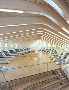 Vennesla, Norway The main structure of the library area is formed by 27 laminated wood ribs, which support the ceiling and then curl down to the floor to provide functional elements such as bookshelves and seating. The ribs also conceal required building components, such as air-conditioning ducts and lighting, creating a clean, streamlined envelope that supports quiet contemplation.