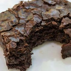 Coca-Cola Brownie Cake ~ 1 3/4 c sugar; 2 1/2 c flour; 3/4 c cocoa powder; 1/4 c butter; 1 tsp baking powder; 2 eggs; 1 tsp vanilla extract; 1 can Cola     Preheat oven to 350 degrees, grease a 9 x 9 inch pan.Combine all ingredients except vanilla extract and Coca-Cola. Blend at low speed of mixer, then beat 2 minutes at medium speed. Add vanilla extract and Cola and blend well by hand. Pour into pan. Bake  for 35 minutes. Let cool before cutting into squares to remove from pan.