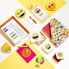 GRAPHICAL EMOJI VIBES  for @johnlewisretail styled by @rebeccanee_ art director @get_frances #stilllife #emoji #graphical       #tv_stilllife #still_life_gallery #stilllifephotography #studio #lightandshadow #lookingdown #stillography #emoticon # stationary #notepad #lunchbox #pen #cup #smillie #heart #yellow #plasters #markers #pop #hot #lol #lulz