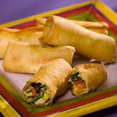"""Southwestern Egg Rolls """"These aren't traditional egg rolls! Small flour tortillas are stuffed with an exciting blend of Southwestern-style ingredients, then deep fried until golden brown. Southwestern Egg Rolls, Southwestern Style, Southwestern Chicken, Egg Roll Recipes, Yummy Recipes, Good Food, Yummy Food, Tasty, Yummy Eats"""