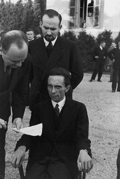 """Nazi propaganda minister Joseph Goebbels at a 1933 League of Nations meeting in Geneva smiled for photos until he found out the photographer was Jewish. As Alfred Eisenstaedt recalls, """"He looked at me with hateful eyes and waited for me to wither. But I didn't wither. If I have a camera in my hand, I don't know fear."""""""