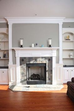 Custom Fireplace wood tops on cabinet....white surround with gray paint on walls