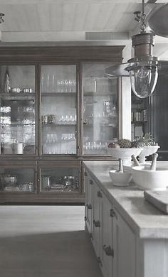 This is my favorite inspiration for the kitchen armoire between the refrigerators. I may need the bottom portion to be solid wood to hide things.