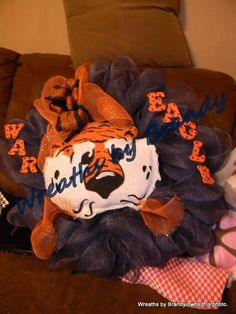 Aubie from Burlap on Navy mesh...sorry for the couch as background..took as walking out the door with it.