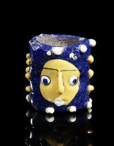 Phoenician glass janiform core-formed head bead  Eastern Mediterranean or North Africa, circa 6th–5th Century B.C.