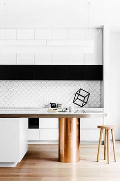 White and black kitchen with metallic kitchen island
