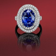 Oval sapphire 8.08cts and brilliant cut diamonds millegrain set ring in platinum