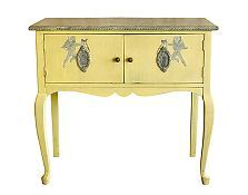 Cheryl Maeder's Lemon vintage console with handpainted cherubs. Measures 34Hx 37W x 19D,