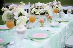 loving the white details on the mint tablecloth
