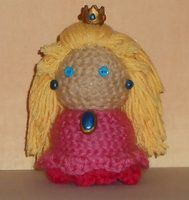 Handmade amigurumi doll based off the character Princess Peach from the Mario game series.