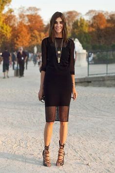 Carine Roitfeld - dress by Givenchy; shoes by Alaia. Paris Fashion Week, 2011.