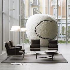 'Romeo Moon' Floor Lamp from Flos is part of the Romeo Moon range by Philippe Starck. It has an acid etched pressed borosilicate glass internal diffuser with pressed clear glass shade to the outer, providing a clear and crisp diffused light. It features an on/off touch dimmer with a chrome plated steel sensor located just below the shade.