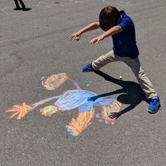 1st graders took art outside to draw their partner's shadows