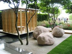 Big boulders to contrast with house. Water, sculptural tree trunks. Japanese garden shallow