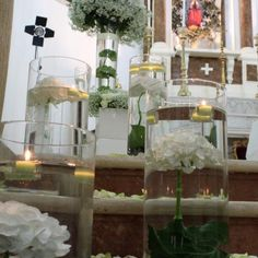 Corflor | White We love the floating candles over the flowers in water. Mind-Blowingly Beautiful Wedding Reception. Cylinder vases in graduated sizes with surrounding flowers. Design and floral elements by Corflor wedding florists in Italy.