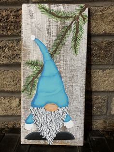 This rustic teal painted gnome is so bright and cute. Painted pine branches overhang the gnome on this rustic white wood sign. Christmas Gnome, Christmas Wood, Christmas Projects, Woodworking Lamp, Woodworking Beginner, Woodworking Organization, Woodworking Patterns, Woodworking Workbench, Woodworking Techniques