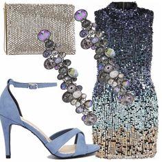 Vestitino in paillettes sulle tonalità del blu, sandali celesti, pochette argentata e orecchini che riprendono fedelmente il colore del vestito vi accompagneranno nelle vostre sfrenate serate in disco.