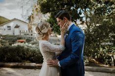 A lil peek at some of the romance goin' on in this couple's first look | Image by Sebastien Bicard Photography