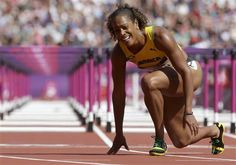 Jamaica's Brigitte Foster-Hylton reacts after competing in a women's 100-meter hurdles heat during the athletics in the Olympic Stadium at the 2012 Summer Olympics, London, Monday, Aug. 6, 2012.