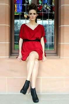 Wedding UK member Mee Mee Couture has designed this cute little red dress, flowing out from a black belt.