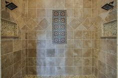 10 Karsten Creek Ct The Woodlands, TX 77389: Photo The walk-in shower showcases dual shower heads and hand painted Talavera tile accents.