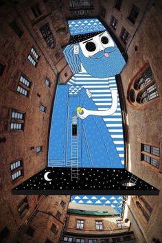 Artista faz desenhos supercriativos no céu, em fotos de edifícios vistos de baixo | Virgula