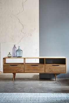 The Redford media unit, grey wash. Simple Scandinavian style, the Redford teams clean lines with handy storage to prove that stylish furniture can be functional too.
