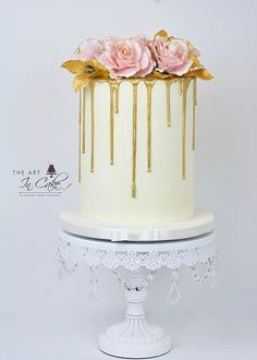 Gold Drip Bridal Shower or wedding cake with rose decorations on top