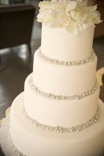 elegant, simple wedding cake with silver pearls